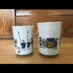 Two small Asian style white pottery cups